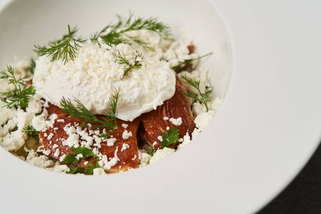 Smoked trout with mashed potatoes and sour cream snow, on white plate. Reklamní fotografie - 138101552