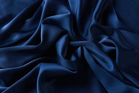 Blue sapphire color silk fabric background, top view. Smooth elegant blue silk or satin luxury cloth texture can use as abstract background with copy space Reklamní fotografie - 138606118
