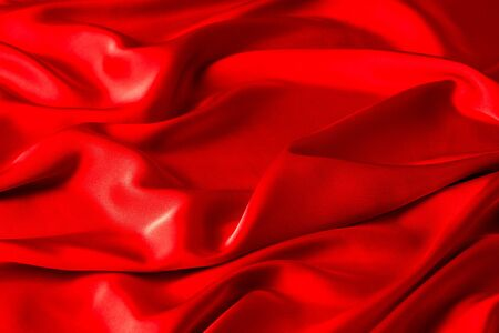 Red ruby color silk fabric background, top view. Smooth elegant red silk or satin luxury cloth texture can use as abstract background with copy space Reklamní fotografie - 138466546