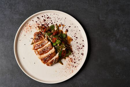 Spicy chicken breast with minted green beans, close-up