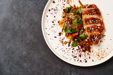 Spicy chicken breast with minted green beans, close-up. Reklamní fotografie