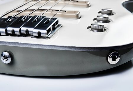 White Electric Bass Guitar strings, close-up.
