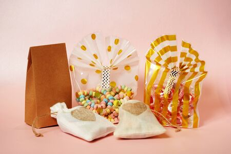 Valentines day sweets set. Valentine day gift bag with hearts on a pink background with copy space, close-up