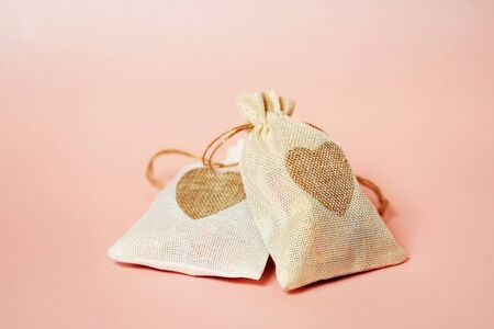 Valentines day sweets set. Valentine day gift bag with hearts on a pink Reklamní fotografie
