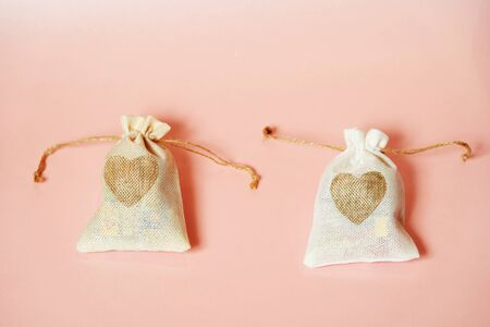 Valentine's day sweets set. Valentine day gift bag with hearts on a pink Stock Photo