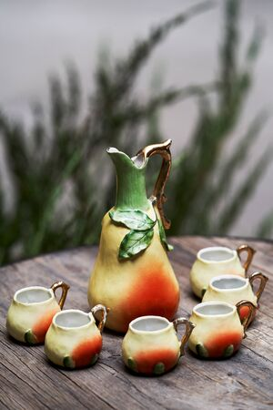 Pear tincture beverage set with pear drink jug and shot glass. Fresh Pear juice on a table, close-up. Banco de Imagens