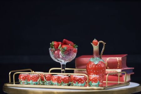 Strawberry liqueur with fresh strawberries, jug and glass shots. Fresh strawberry cocktail, close-up.  Banco de Imagens