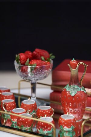 Strawberry liqueur with fresh strawberries, jug and glass shots. Fresh strawberry cocktail, close-up.