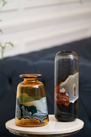 Decorative flower vases on a table, close-up. Abstract glass vase for home decor