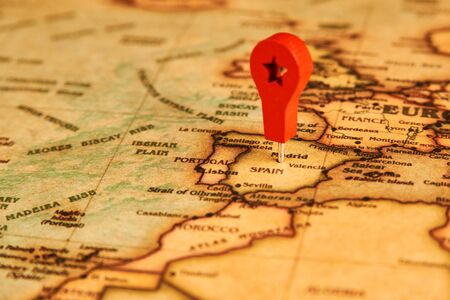 Spain marked on map with map pin. Europe With map marker on Madrid city , close-up.