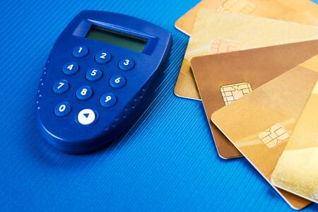 Secure wireless payment concept. Gold credit cards and security remote for pin code entering. Digital pin code generator Reklamní fotografie