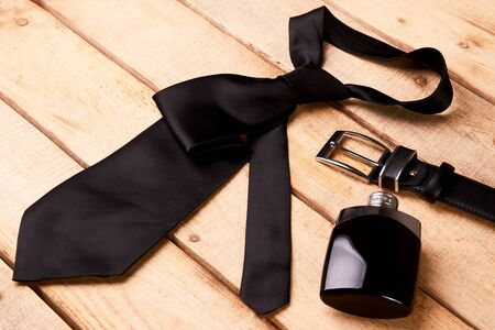 Stylish men accessories, men's fashion. Happy Father's Day concept with necktie, perfume bottle, leather belt and sunglasses Stock fotó