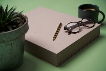Education background concept with books, coffee cup, reading glasses, pen and pencils. Abstract interior decoration background
