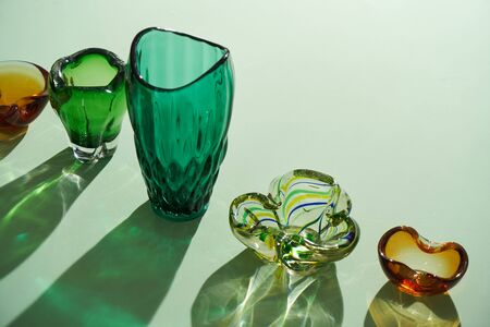 Interior decor elements. Flower vases for home decor. Colorful glass vintage vases