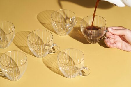 Vintage coffee cups collection. Retro glass tea cups with reflection.  Banque d'images