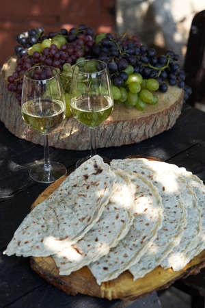 Wine and snack set. Antipasto and catering table. Two glasses of wine and italian snacks, outdoor restaurant.