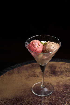 Sundae ice cream in glass.  Chocolate ice cream balls on restaurant table