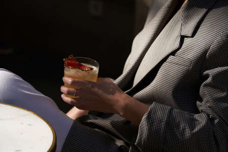 Red cocktail in martini glass with cherry. Exotic alcoholic cocktail on table Banco de Imagens