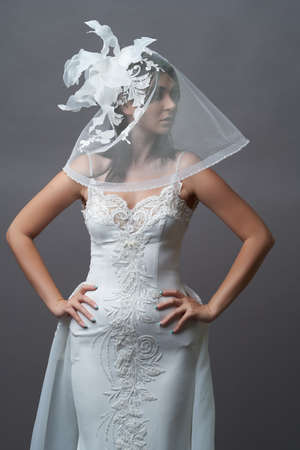 Portrait of beautiful bride in wedding dress with veil