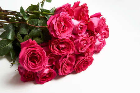 Bouquet of pink roses on white background with copy space. Beautiful red rose bouquet flower. Valentines day flowers