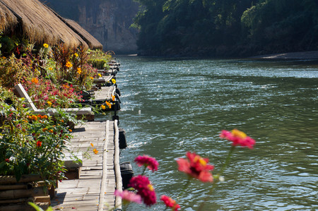 house float on water: Floating Raft Hotel on the River Kwai in Thailand. Beautifully decorated with flowers.