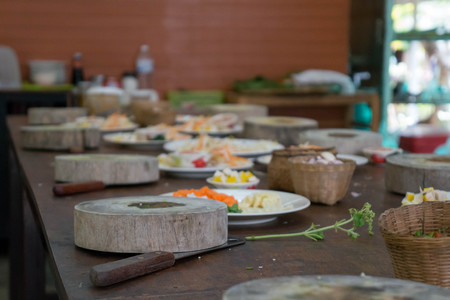 A wooden cutting block and healthy ingredients for an asian meal at a cooking class