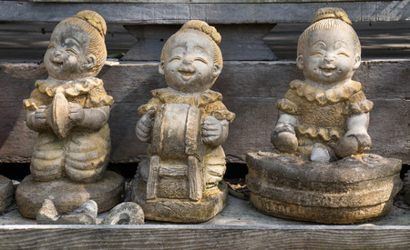figurines: Small smiling figurines in Thailand Stock Photo
