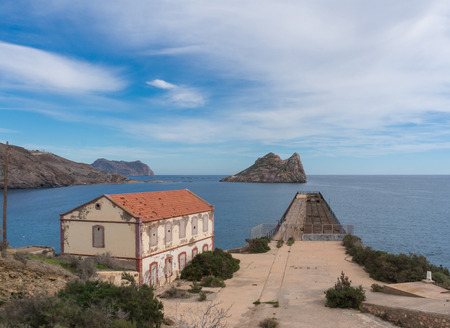 damaged roof: The old Embarcadero de Mineral el Hornillo in Aguilas, Spain. It was used to move ressources from trains to ships and vice versa.
