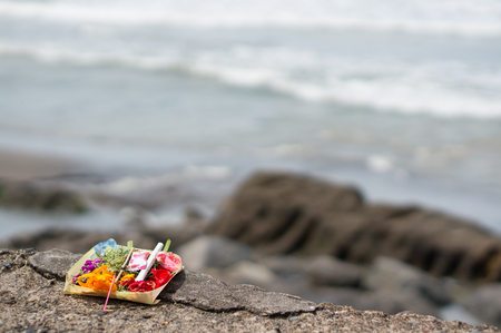 Balinese Offering on Batu Bolong Beach in Canggu with the Waves of the Ocean in the Background