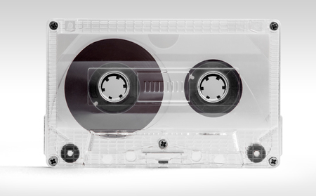 Audio cassette. Close up of a vintage transparent audio tape isolated on white background with clipping path.
