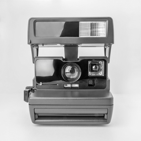 Close Up Instant Camera. Instant camera isolated on white background.