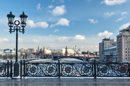 Patriarshy Bridge, Fence and Lantern, Kremlin and the Variety Theatre, bridge and Moscow river.