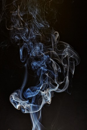 Smoke fragments on a black background. Stock Photo