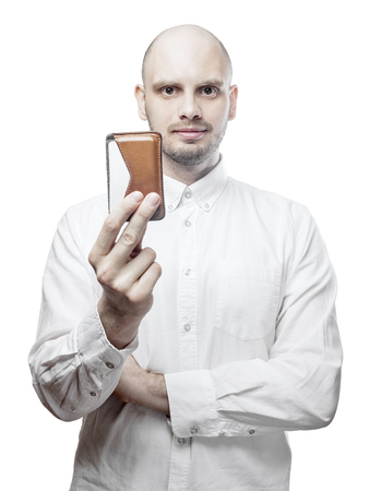 Handsome man in white shirt with wallet. Isolated on white background with clipping path. Stock Photo