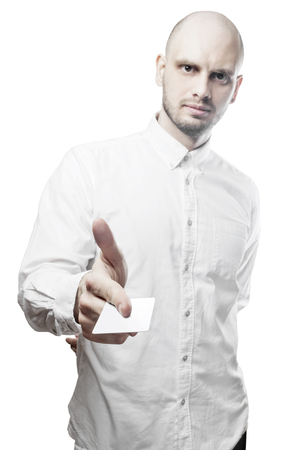 Handsome man in white shirt with white blank card. Isolated on white background with clipping path.
