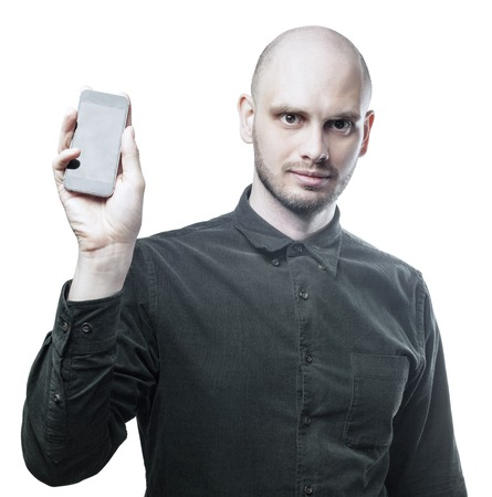 Handsome man in black shirt with smartphone. Isolated on white background with clipping path.