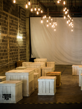 timber bench seat: wooden box used as chairs and tables in loft cinema