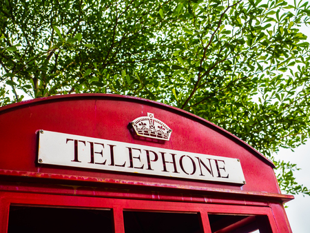 phonebooth: Traditional British red telephone box close-up.