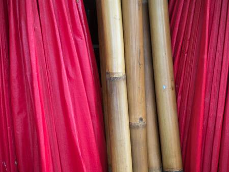 umbella: stack of red umbella and woodenbamboo Stock Photo