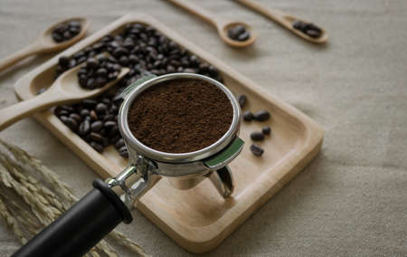 automat: fresh coffee beans and coffee maker prepared on the desktop