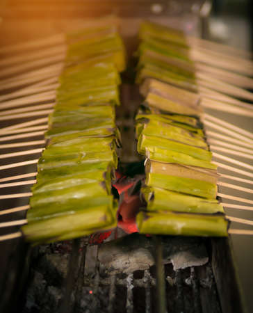 squids: Squids wrapped in banana leaves. street food in Thailand.