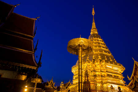 night time: Buddhist golden pagoda in night time at Doi Suthep temple Chiangmai Thailand Stock Photo