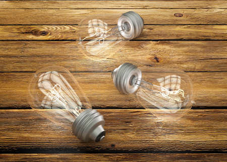electrical materials: Vintage light bulbs on brown wood background Stock Photo