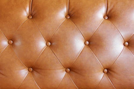 brown leather: Brown leather sofa texture background with details