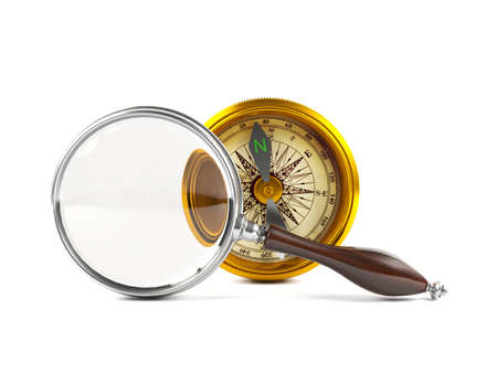 amplify: Magnifying glass investigate golden compass Stock Photo