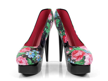 fetishes: Female high heeled shoes with flower pattern isolated on white background, front view Stock Photo