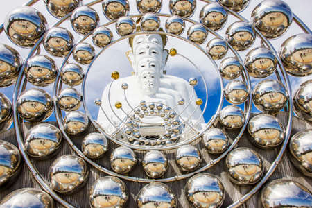 godlike: The white statue of five Lord Buddha at Wat Pra Tat Son Kaew, Petchaboon province, Thailand