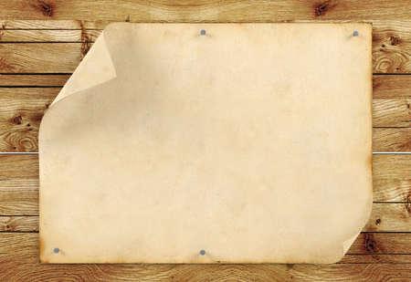 Old blank vintage paper on wood background