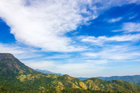 mountaintop: Mountain range under cloud blue sky for nature background