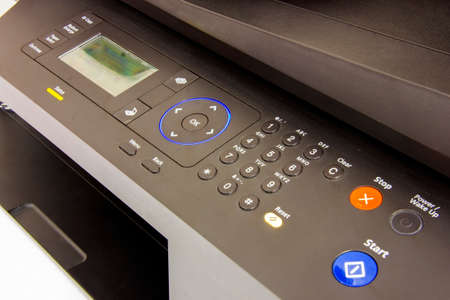 input device: Buttons on printer panel for technology background